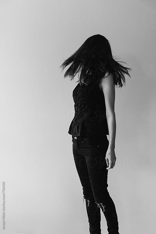 Woman shaking her hair  by Jacqui Miller for Stocksy United
