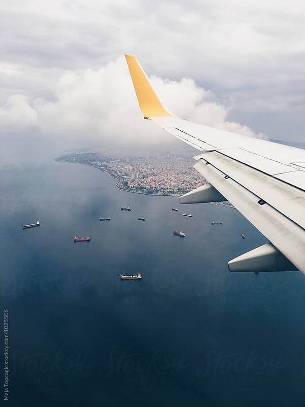 Aeroplane shot of a harbour by Maja Topcagic for Stocksy United
