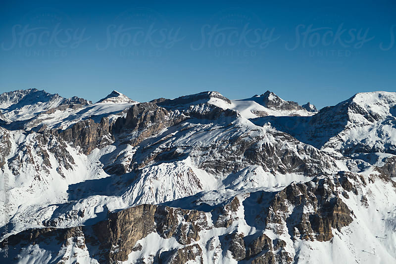 snow mountain and blue sky with copyspace by Sonja Lekovic for Stocksy United