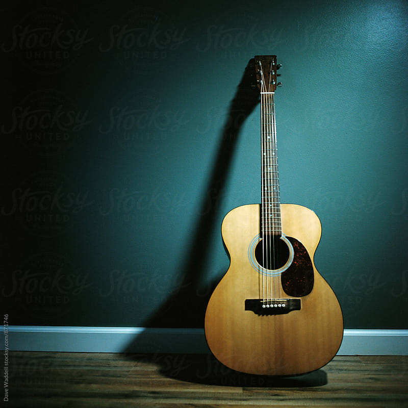 Acoustic Guitar leans on wall by Dave Waddell for Stocksy United