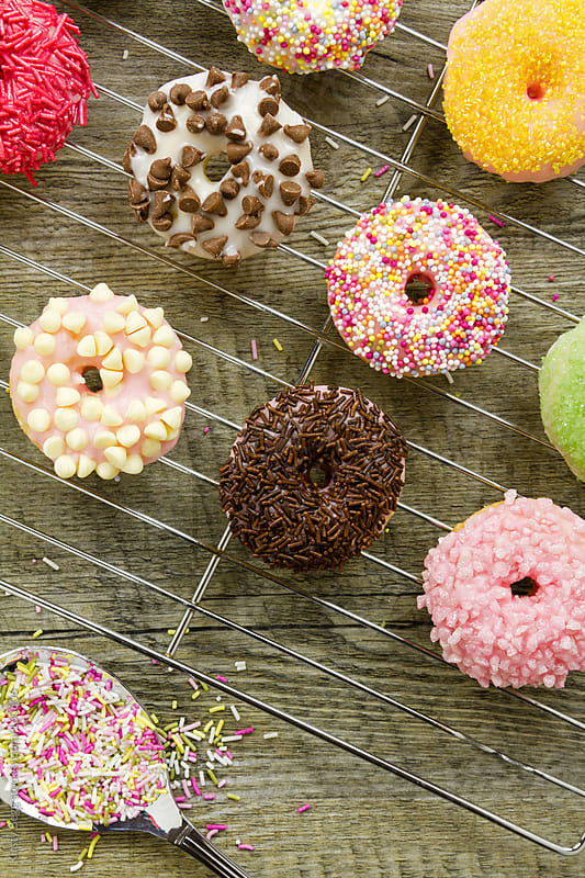 Iced doughnuts overhead by Kirsty Begg for Stocksy United