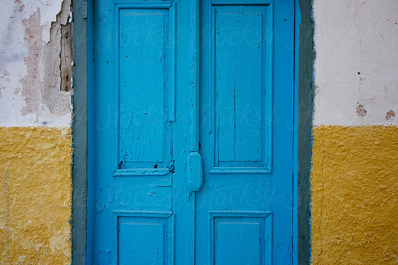 Blue door in Greece by Kirstin Mckee for Stocksy United