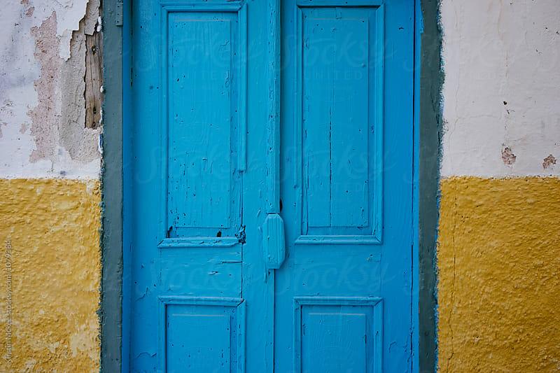 Blue door in Greece by Kirstin Mckee for Stocksy United