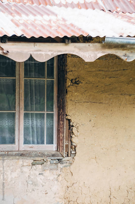Rustic window detail on abandoned house by Rowena Naylor for Stocksy United