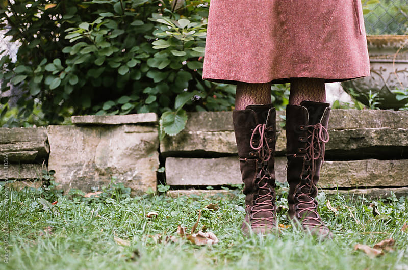 Woman's legs with brown boots by Gabriel (Gabi) Bucataru for Stocksy United