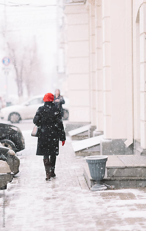 Woman walking on the street by Vesna for Stocksy United