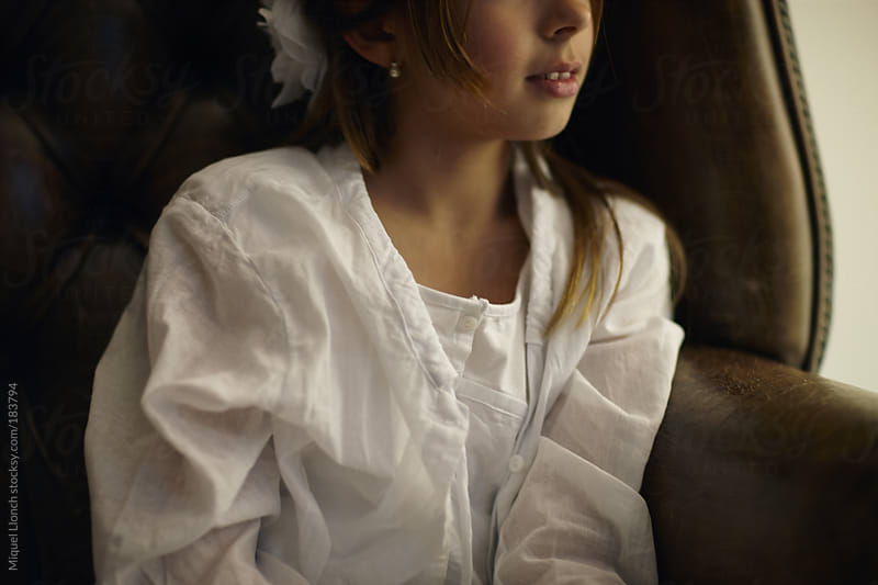 Portrait of a young girl with dress by Miquel Llonch for Stocksy United
