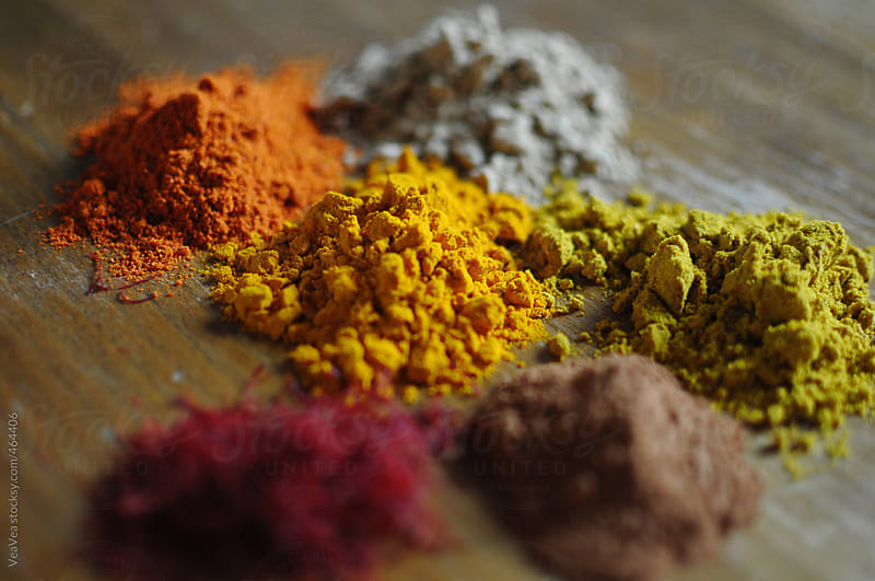 Colorful spices on a desk by VeaVea for Stocksy United