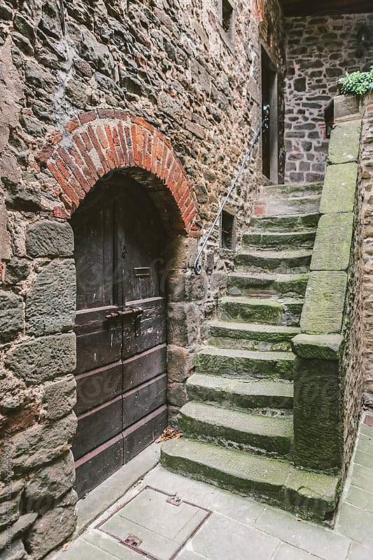 Wooden Doorway and Old Staircase in an Ancient Tuscan Village by Giorgio Magini for Stocksy United