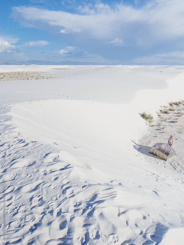 Young female camping alone in desert. White Sands, New Mexico by Jeremy Pawlowski for Stocksy United