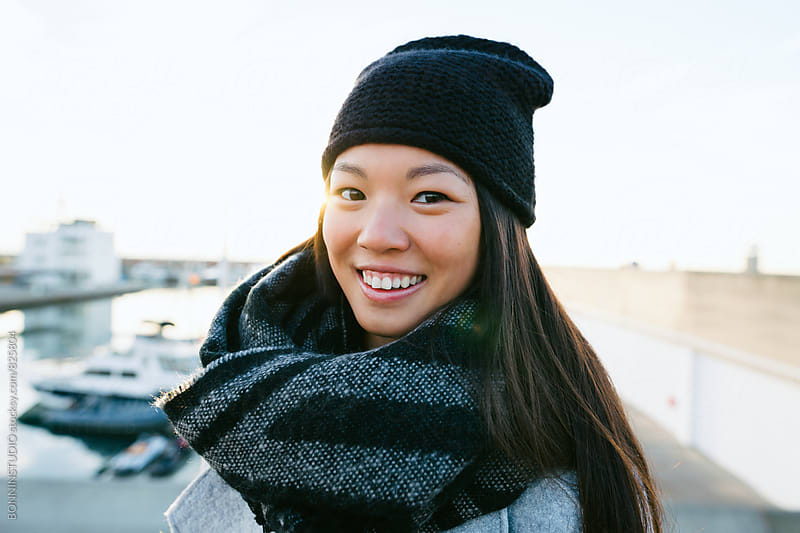 Portrait of a chinese woman smiling on winter. by BONNINSTUDIO for Stocksy United