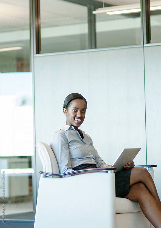 Young businesswoman  at a modern office by W2 Photography for Stocksy United