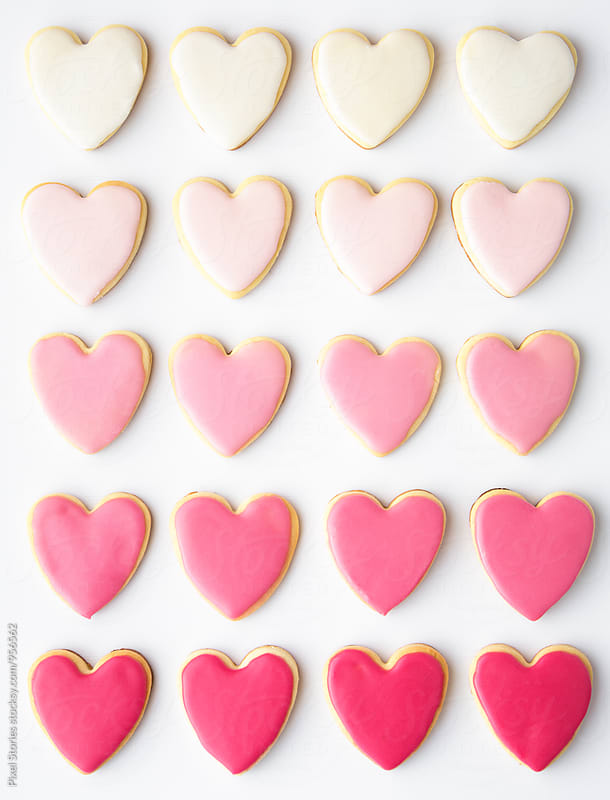 Heart-shaped valentine cookies with pastel glazing by Pixel Stories for Stocksy United