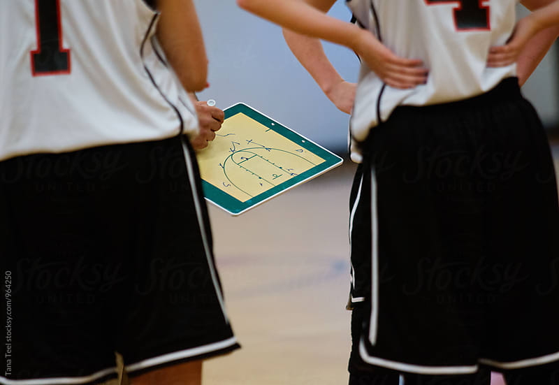 basketball play drawn on clipboard by Tana Teel for Stocksy United
