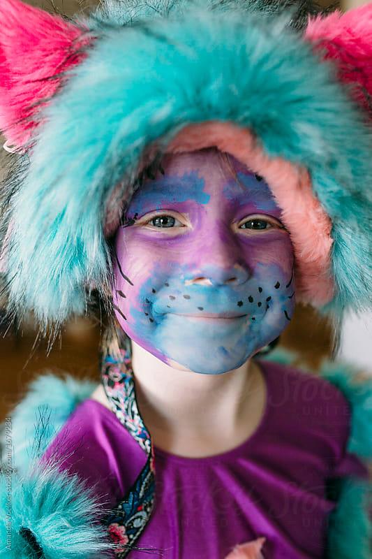 Little Happy Girl in Purple Homemade Cat Costume by Amanda Voelker for Stocksy United & Little Happy Girl in Purple Homemade Cat Costume - Stocksy United