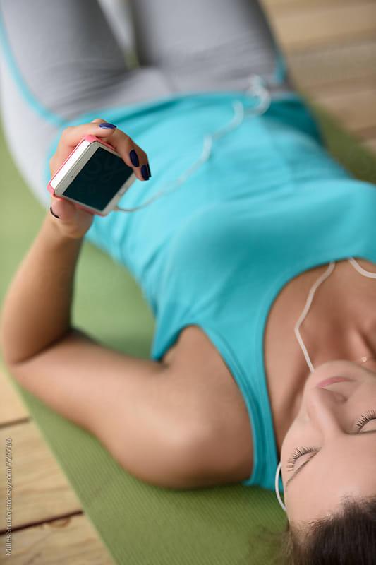 Sportswoman listening music by Milles Studio for Stocksy United