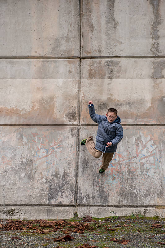 Boy Doing Parkour by Ronnie Comeau for Stocksy United
