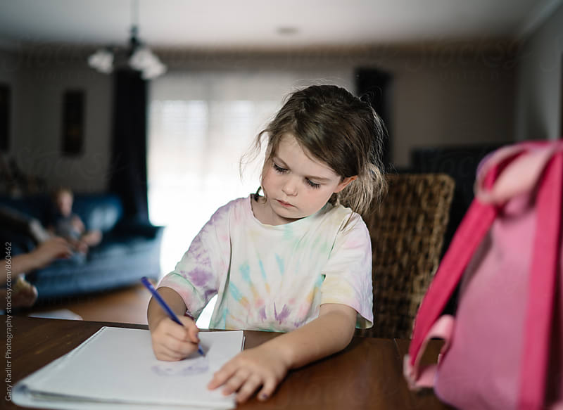 Girl at Home Drawing on a Notepad by Gary Radler Photography for Stocksy United