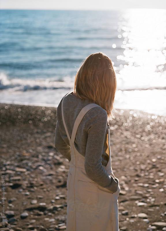 Woman at the seaside by Liubov Burakova for Stocksy United