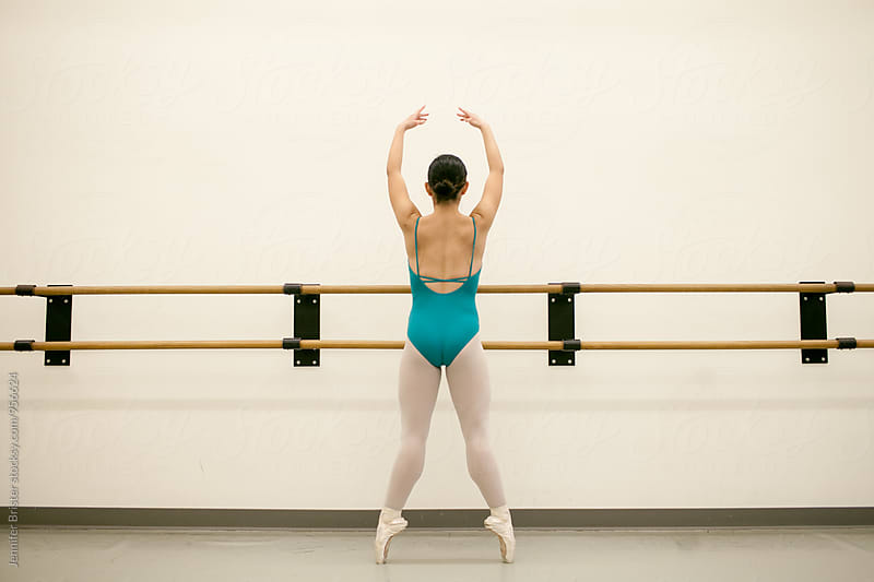 Graceful female dancer on toes by Jennifer Brister for Stocksy United