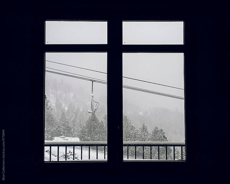 winter mountain view through the window  by Jordi Rulló for Stocksy United
