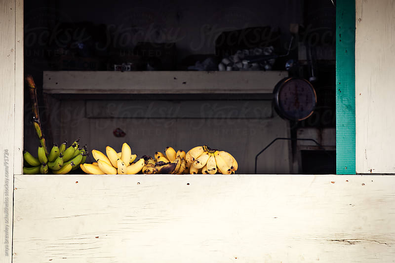 Bundles of bananas on the ledge of an old store by anya brewley schultheiss for Stocksy United