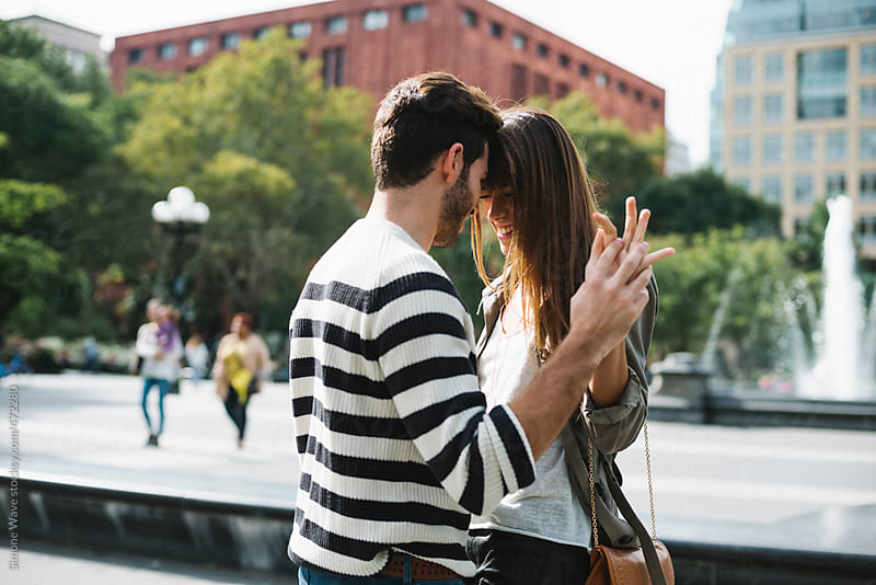 Affectionate happy young couple having fun in the city by GIC for Stocksy United