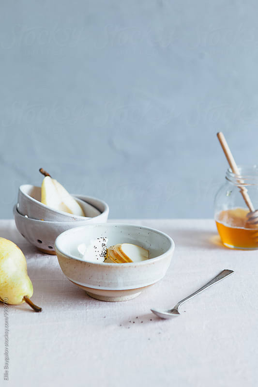 Pear yogurt bowl by Ellie Baygulov for Stocksy United