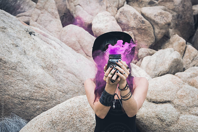 Witchy Woman with Purple Smoke  by MEGHAN PINSONNEAULT for Stocksy United