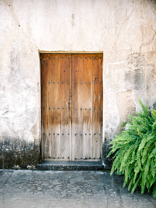 Old wooden door by Daniel Kim Photography for Stocksy United