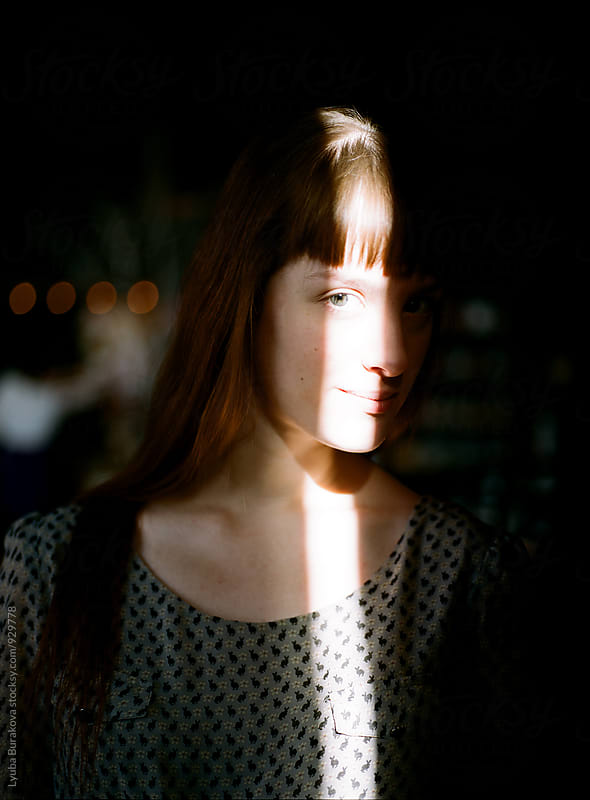 Ray of light on woman's face by Lyuba Burakova for Stocksy United