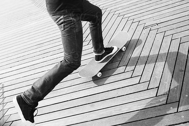 Close up of a skater riding, feet and skateboard by Ivo de Bruijn for Stocksy United