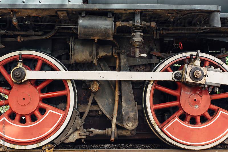 Old steam engine wheels by Gabriel (Gabi) Bucataru for Stocksy United