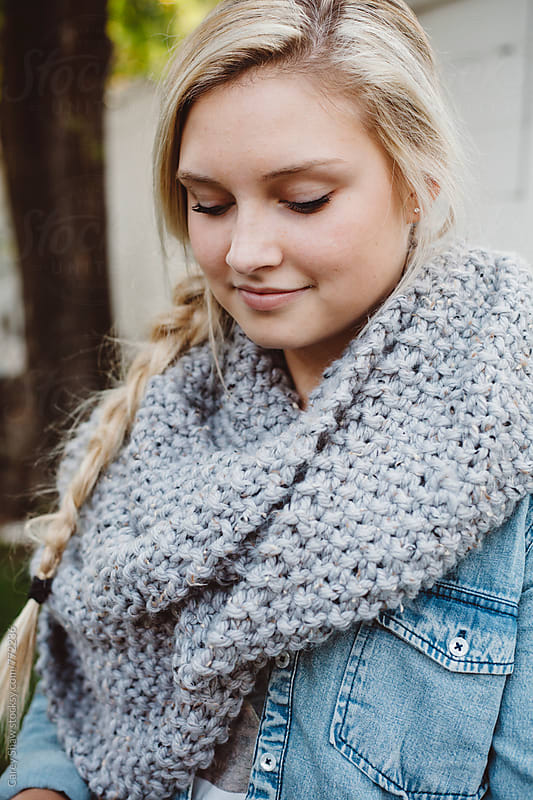 Beautiful young woman wearing grey knit scarf by Carey Shaw for Stocksy United