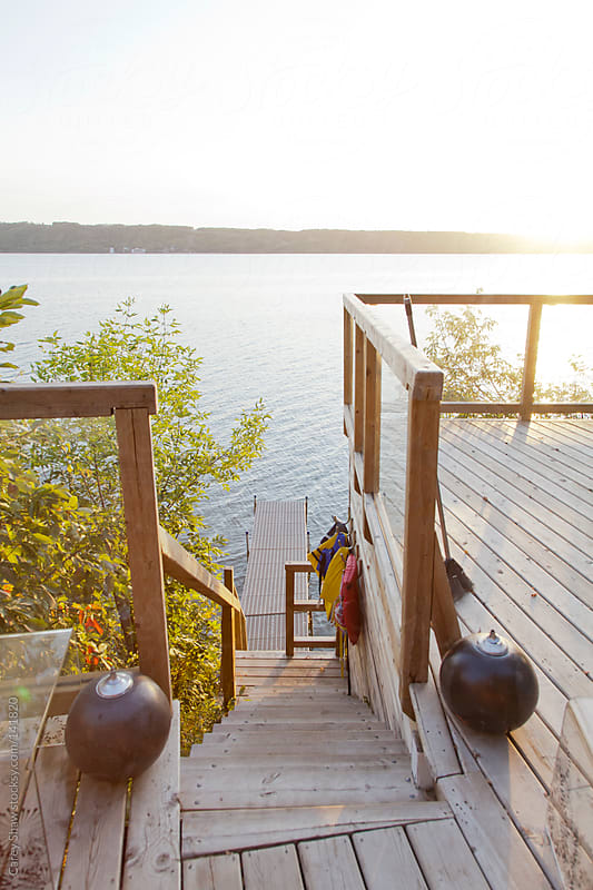 Lakefront cabin and dock by Carey Shaw for Stocksy United