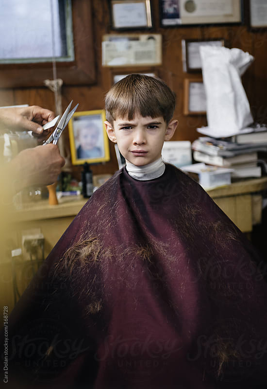 Little boy is pretty annoyed about getting a haircut by Cara Dolan for Stocksy United