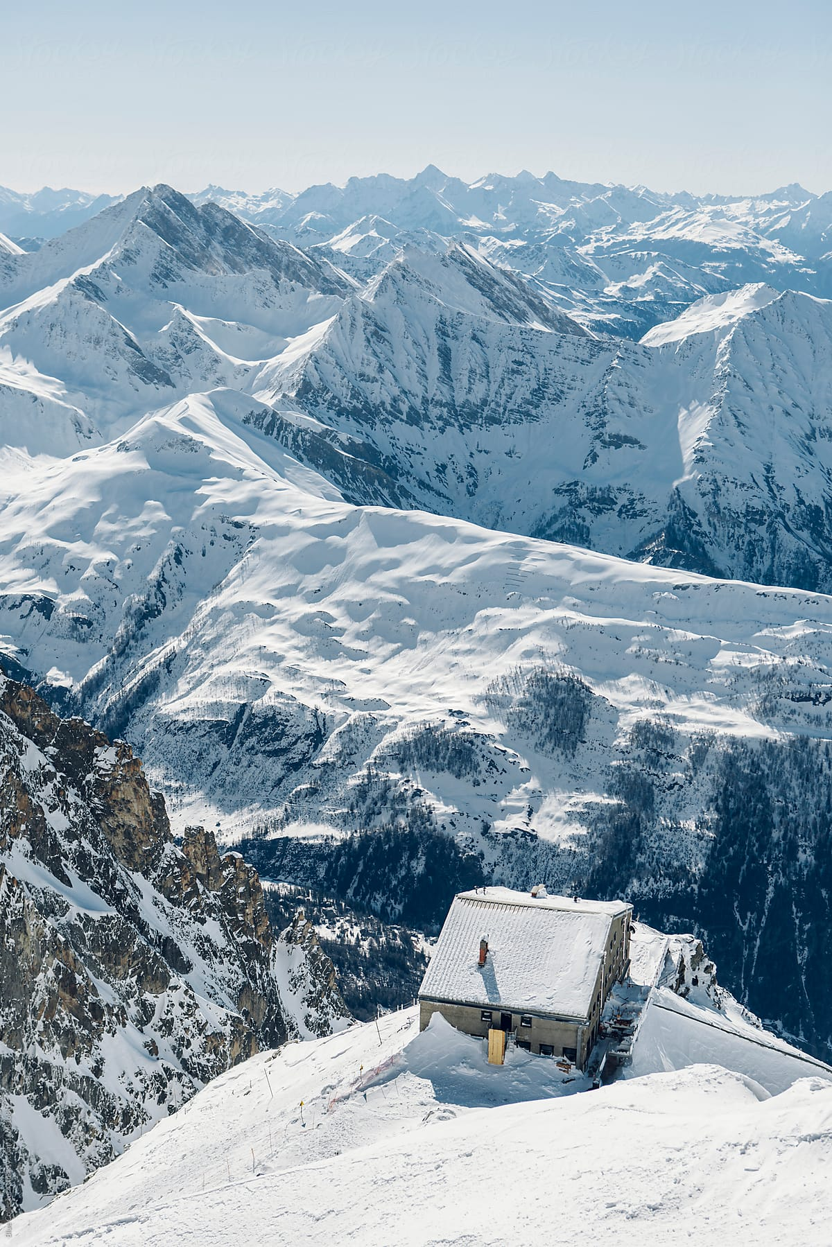 Winter mountain cabin covered in snow in the top of the