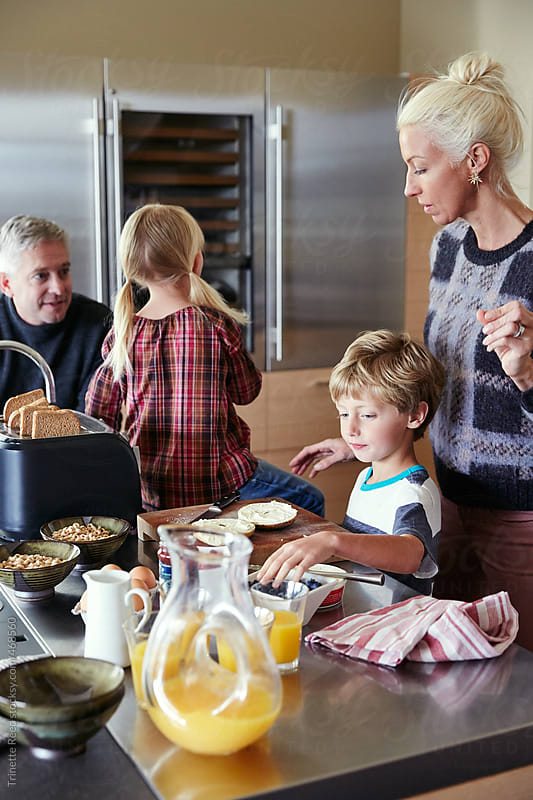 Family making breakfast together in the kitchen by Trinette Reed for Stocksy United