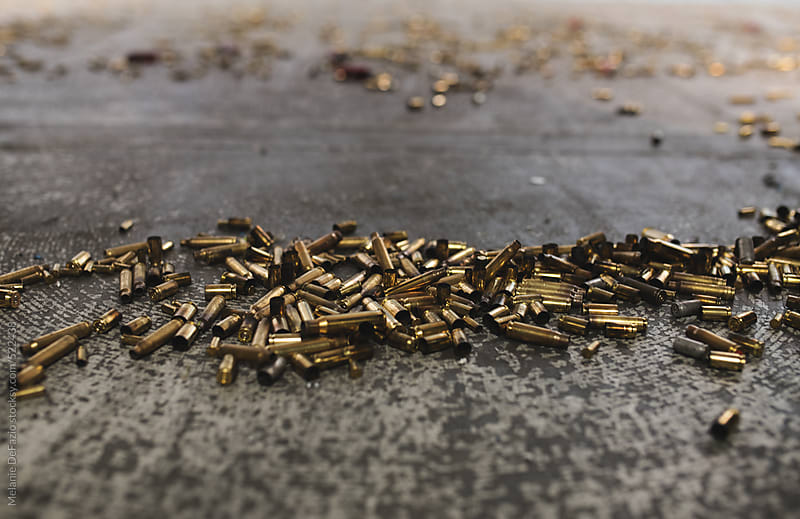 Spent gun shell casing's by Melanie DeFazio for Stocksy United