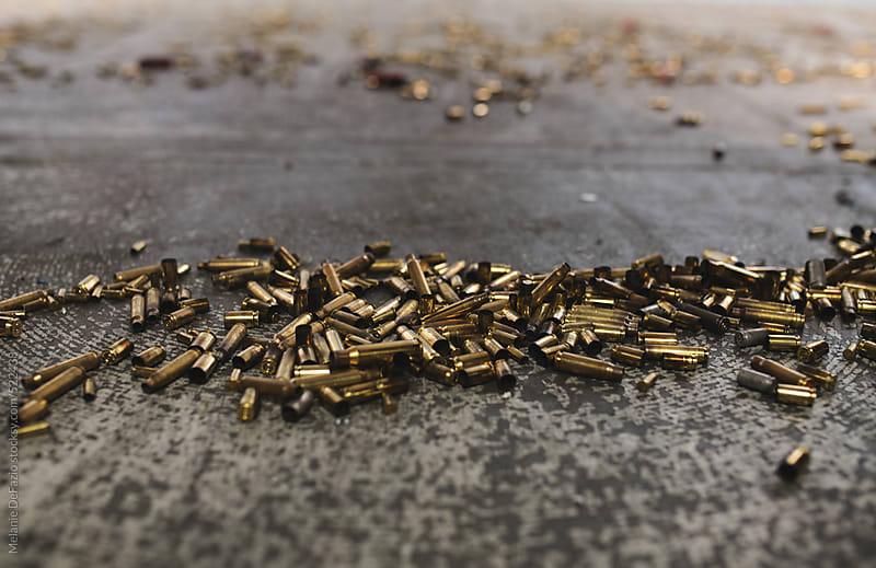Spent gun shell casing's by Melanie DeFazio for Stocksy United