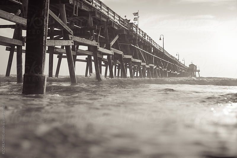 Black and white image of a pier. by RZ CREATIVE for Stocksy United
