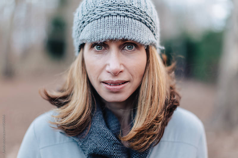 Close up portrait of a beautiful woman in a beanie by Jakob for Stocksy United