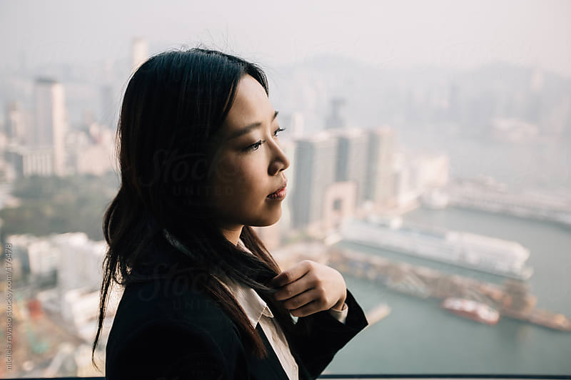 Portrait of a young asian businesswoman by michela ravasio for Stocksy United