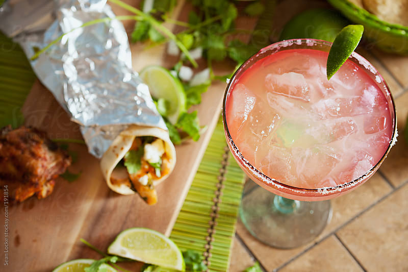 Fiesta: Focus On Margarita with Wrapped Taco Behind by Sean Locke for Stocksy United