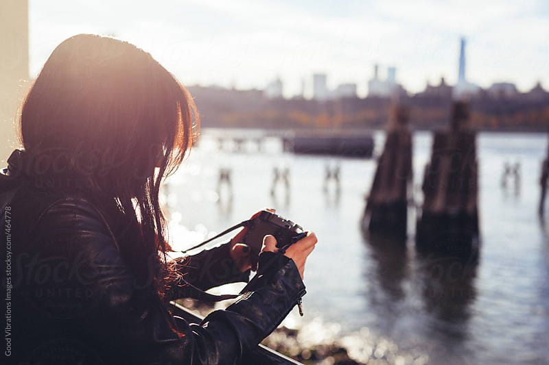 Attractive woman holding a digital camera in New York by Good Vibrations Images for Stocksy United