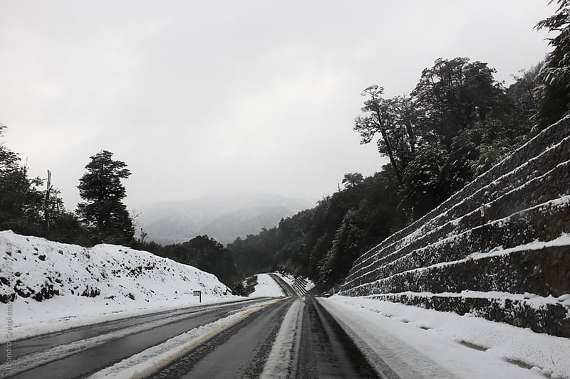 Snowy empty road across Patagonia by Leandro Crespi for Stocksy United