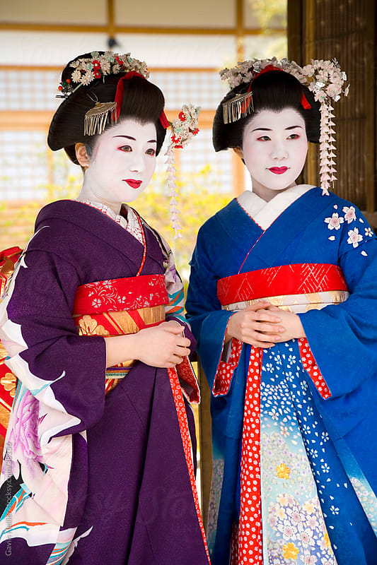 Asia, Japan, Honshu, Kansai Region, Kyoto, portrait of two maiko (apprentice Geisha) wearing traditional Japanese Kimono's by Gavin Hellier for Stocksy United