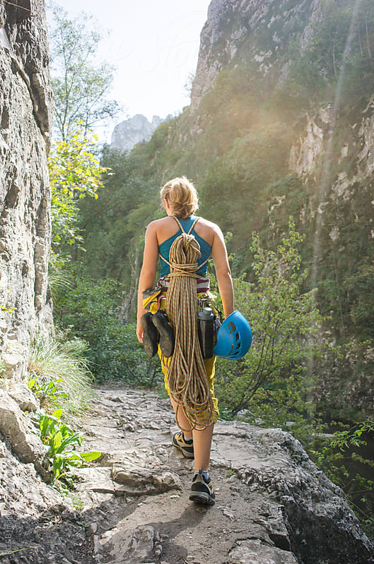 Alpinist carrying climbing gear  by RG&B Images for Stocksy United