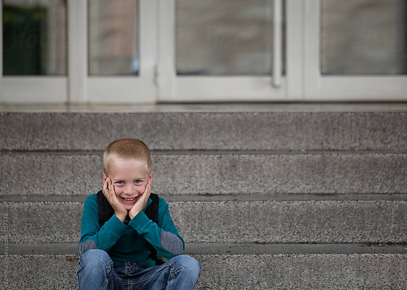 Smiling Boy Sitting on the Stairs by Lumina for Stocksy United