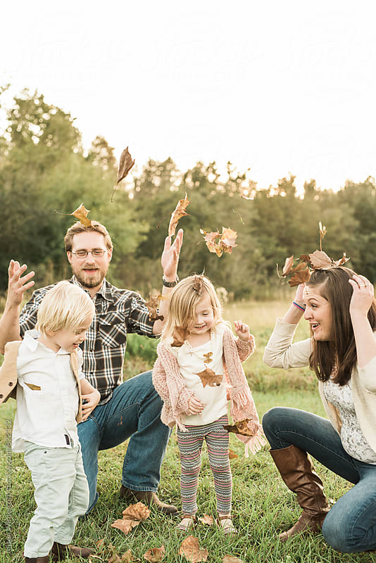 Family Tossing Leaves Up In The Air by Alison Winterroth for Stocksy United